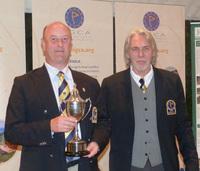Bruno Steensels, left, receives the President's Cup from Rainer Preissmann, EIGCA President